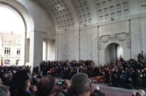 "With the band playing ""O Valiant Hearts"", poppy petals fall during the Armistice Day Last Post Ceremony at the Menin Gate – 2013 Armistice Day in Ypres and Battlefield Tour"
