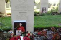 Grave of Lieutenant M J Dease, awarded first VC of WWI. Behind is the grave of Private George Lawrence Price – Mons and Ypres Battlefield Tour