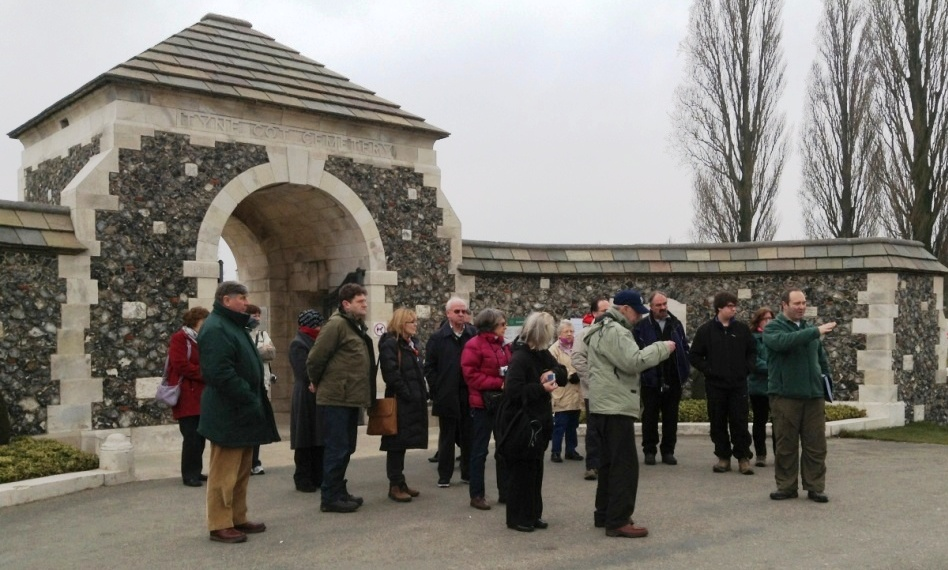 01 Tour party at the entrance to Tyne Cot