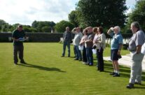 The tour party listen to guide Iain at Gommecourt Cemetery – Somme Battlefield Tour