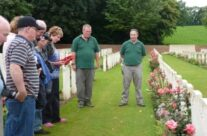 A personal visit for Liz as she waits to lay her wreath as Tony gives the Exhortation at her relative's grave at Heilly Station Cemetery – Somme Battlefield Tour