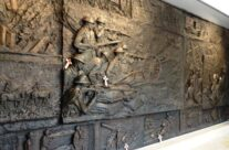 Inside Delville Wood Memorial Museum, Bronze wall sculptures, Somme and Ypres Battlefield Tour