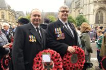 Tony Eden of Rifleman Tours with George Lowe waiting for the Poppy Parade to begin – Armistice in Ypres and Passchendaele 100 Anniversary Battlefield Tour