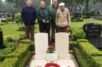 The 'Easy Boys' Group at the Graves of Gibson and Warwick in rainy Steenbergen Roman Catholic Cemetery – Dam Busters Private Battlefield Tour