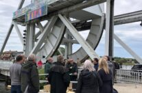 The group around Wally Parr's at Pegasus Bridge – Normandy and D-Day Landings 75th Anniversary Tour