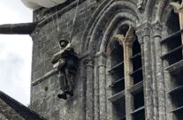 An effigy of trapped paratrooper John Steele on the spire of the church at St Mère Eglise – Normandy and D-Day Landings 75th Anniversary Tour