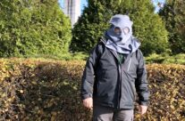 Tony with WW1 gas mask at the Brooding Soldier Canadian memorial at Vancouver Corner – Somme and Ypres WW1 Battlefield Tour