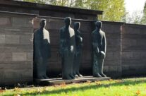 Statues watching over the Comrades Grave at Langemark German Military Cemetery – Somme and Ypres WW1 Battlefield Tour