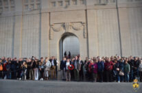 Members of the group taking part in the Last Post Ceremony at the Menin Gate in Ypres – Gardens of Stone book by Stephen Grady WW2 Tour