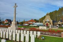 Hooge Crater Cemetery with the Hooge Crater Museum and Cafe in background – Somme and Ypres Battlefield Tour