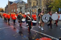 North Devon Pipes and Drums band forming up for the Poppy Parade from St Martin's Cathedral, Ypres on Armistice Remembrance Day – 2016 Armistice Day in Ypres and Battlefield Tour
