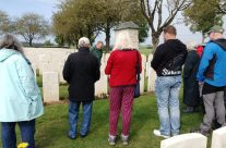 The group at the grave that had belonged to the New Zealand Unknown Soldier, Caterpillar Valley Cemetery, Somme and Ypres Battlefield Tour