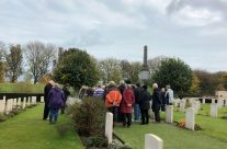 The group at Rifleman Strudwick's grave at Essex Farm Cemetery – 2018 Armistice Remembrance Day in Ypres
