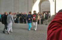 Tour party members Moira and Eileen going to lay a wreath at the Last Post Ceremony, Menin Gate – Somme and Ypres Battlefield Tour