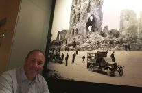 Tony with a picture of how the Grote Markt in Ypres looked after the war – Armistice in Ypres and Passchendaele 100 Anniversary Battlefield Tour